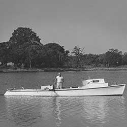 A waterman crabbing with a trotline in a Hoopers Island dovetail, c. 1967. Photograph by Caryl Firth. Collection of the Chesapeake Bay Maritime Museum, St. Michaels, MD. Gift of the photographer.